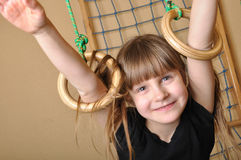Child playing at gymnastic rings Stock Photos