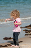 Child playing happily on the beach Royalty Free Stock Photography