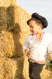 Child playing in a haystack. Royalty Free Stock Photos