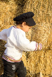 Child playing in a haystack. Stock Image