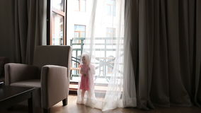 Child Playing Hide and Seek, Happy Little Girl Playing with Curtains, Children. Full HD. 1920x1080 stock video