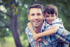 Child playing with his father Stock Image