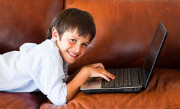 Child playing with his laptop Royalty Free Stock Photo