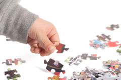A child is playing his puzzle Stock Image