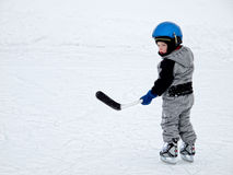 Child playing hockey Stock Photography