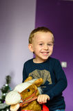 Child playing  at home. Smiling  boy   with   Rocking horse Royalty Free Stock Image