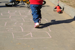Child playing hopscotch Stock Photos