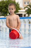 Child playing  in hotel swimming pool Stock Photos