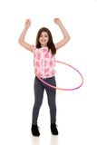 Child playing with hula hoop Stock Photo