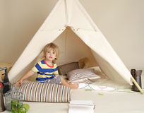 Child Playing Indoors with Teepee Tent Stock Photos