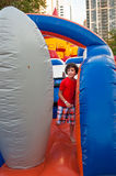 Child Playing in Inflatable Playground Royalty Free Stock Photo