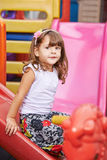 Child playing inside on slide Royalty Free Stock Photo
