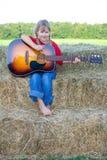 Child playing instrument. Stock Image