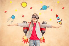 Kid with jet pack at home. Child playing with jetpack. Kid with jet pack at home. Success, creative and startup concept stock photos