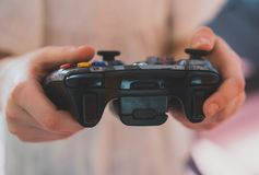 Child playing with joystick. stock images