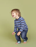 Child Playing Jumping Dancing and Having FUn Royalty Free Stock Image