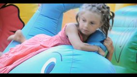 Child playing and jumping on trampoline stock video footage