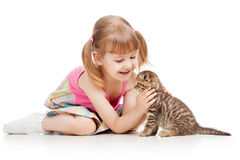Child playing with kitten Royalty Free Stock Photo