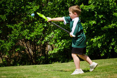 Child playing lacrosse. Child lacrosse player throwing ball stock photos