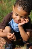 Child Playing with Ladybug Stock Photos