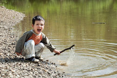 Child playing by the lake stock photos