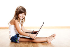 Child playing with a laptop Royalty Free Stock Photos