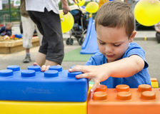 Child playing with large building blocks Royalty Free Stock Photography