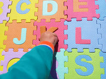 Child playing and learning withl puzzles Stock Photo