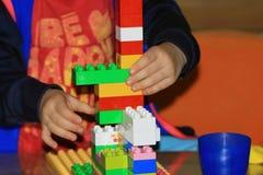 Child playing lego Stock Image