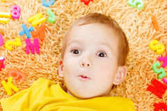 Child playing with letters beginning of the year. Royalty Free Stock Image