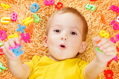 Child playing with letters beginning of the year. Royalty Free Stock Photo