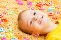 Child playing with letters beginning of the year. Stock Photo