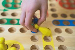 Child playing Ludo board game. Close-up view Royalty Free Stock Photos