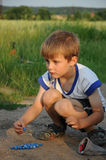 Child playing marbles Royalty Free Stock Images