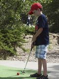 Child Playing Miniature Golf Stock Images