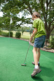 Child playing miniature golf Stock Photo