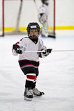 Child playing minor hockey in the arena Royalty Free Stock Image