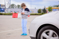 Child playing mobile games on smartphone on the street Royalty Free Stock Photo