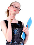 Child Playing or Mocking Teacher. Fourteen year old girl making fun of teacher wearing think lensed glasses and holding folders while pointing finger at naughty Royalty Free Stock Photos