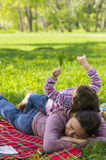 Child playing on mother's back Stock Photography