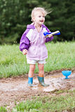 Child Playing in Mud Puddle Royalty Free Stock Photo