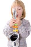 Child playing music on saxophone Royalty Free Stock Photo