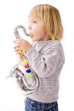 Child playing music on saxophone