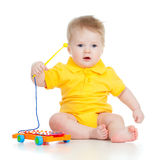 Child playing with musical toys Royalty Free Stock Images