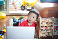 Child playing with notebook Royalty Free Stock Photo