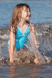 Child playing in the ocean. Little girl playing in the ocean waves Royalty Free Stock Image