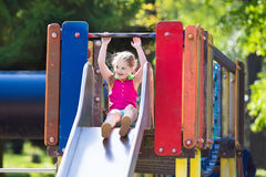 Child playing on outdoor playground in summer Royalty Free Stock Image