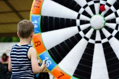 Child playing outdoor - throwing to target Stock Image