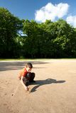 Child playing outdoors Royalty Free Stock Image