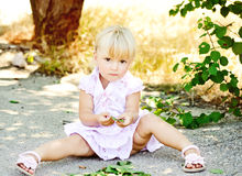 Child playing outdoors Stock Images